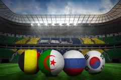 Footballs in group h colours for world cup Stock Images
