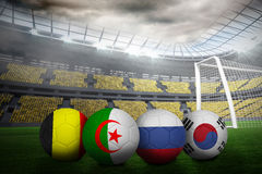 Footballs in group h colours for world cup Stock Photos