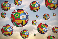Footballs in international flags Royalty Free Stock Photos