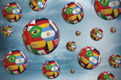 Footballs in international flags Stock Photo