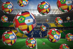 Footballs in international flags Stock Photos