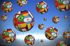 Footballs in international flags Stock Images