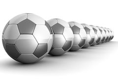 Footballs in a row teamwork concept. Silver shiny football with reflection isolated 3d illustration Stock Photos