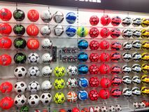 Footballs or soccer balls on display in a sports store. Royalty Free Stock Images