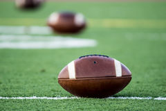 3 footballs on turf Royalty Free Stock Images