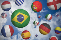 Footballs in various flag colours Royalty Free Stock Photography