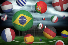 Footballs in various flag colours Stock Photography