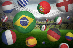 Footballs in various flag colours Royalty Free Stock Images