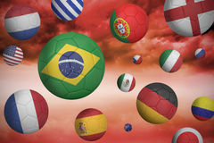 Footballs in various flag colours Stock Photos