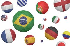 Footballs in various flag colours Royalty Free Stock Photo