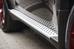 Footboard of the car. Of silvery color with a structure Stock Images