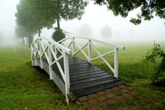 Footbridge. A footbridge in a misty parc. With space for copy royalty free stock images