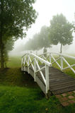Footbridge. A footbridge in a misty parc. With space for copy stock photo