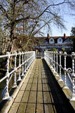 Footbridge. Perspective image of a Victorian Footbridge over a river Royalty Free Stock Photos