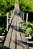 Footbridge. An old footbridge over a river, made with steel cables and eucalyptus wood Stock Images