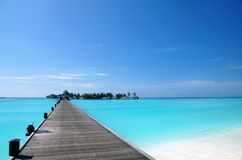 Footbridge. Over turquoise ocean on an maldivian island Royalty Free Stock Photo