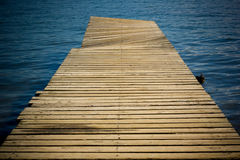 Footbridge 3. Footbridge on the blue water in a sunny day Royalty Free Stock Image