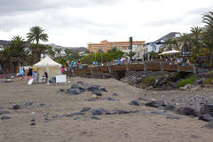 A footbridge across the dry river bed and fllood defense channel in Playa Las Americas in Teneriffe in the Canary Islands Stock Photos