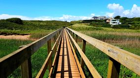 Footbridge across a salt marsh. At Milton sands ley. Devon uk stock photography