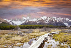 Footbridge in Andes, Fitz Roy mountain range, Argentina. Royalty Free Stock Images