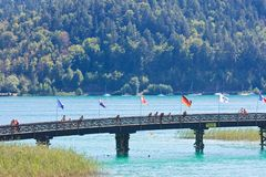 Footbridge on the beach in Portschach. Austria Royalty Free Stock Photo