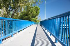 Footbridge with blue railing Stock Images