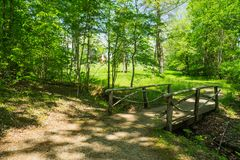 Footbridge at the Booker T Washington Monument. Hardy, VA – May 6th; View of footbridge along a walking trail at the Booker T Washington Monument located stock images