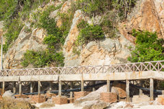 Footbridge and cliff on the beach Stock Images