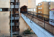 Footbridge connecting street sidewalk with entrance to apartment Stock Image