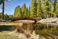 Foot Bridge over Spring Creek Stock Photos