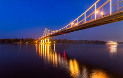 Footbridge in the evening Kiev city. Royalty Free Stock Photography