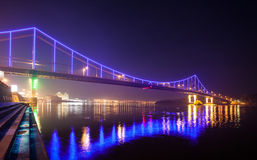 Footbridge in the evening Kiev city. Royalty Free Stock Images