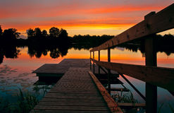 Footbridge in lake. Over sunset Royalty Free Stock Photography