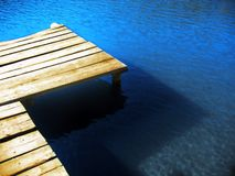 Footbridge on Lake Ana. Footbridge and intense blue lake Stock Photo