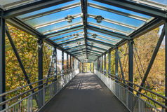 Footbridge. Modern roofed footbridge with a glass roof in the sunny autumn, taken in Herrenberg, Germany Royalty Free Stock Image