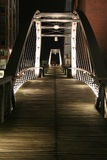 Footbridge at night. Night shot of illuminated pedestrians' bridge above a canal in the modern part of Hamburg harbour Stock Photo