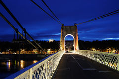 Footbridge by night in Lyon (France) royalty free stock image