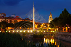 Footbridge  in night. Murcia, Spain. Footbridge over Segura  with Cathedral in background in night. Murcia, Spain Royalty Free Stock Photography