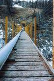 Footbridge. An old footbridge in the mountains Stock Image