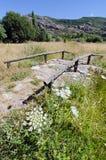 Footbridge. Old wooden bridge over a dry creek Royalty Free Stock Photo