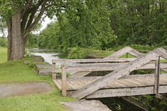 Footbridge. Over Erie Canal lock in upstate NY Stock Photo