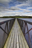 Footbridge over a lake Stock Photos