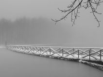 Footbridge over the lake of Gambarie. Gangway Lake Gambarie (Reggio Calabria) obscured by fog Royalty Free Stock Photo
