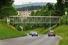 Footbridge over Palacky street. Taken May 28, 2016 Jablonec nad Nisou Czech Republic footbridge over the main road in the background of nature and prefabricated Stock Photo