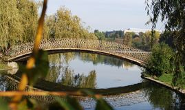 Footbridge over a pond royalty free stock photos