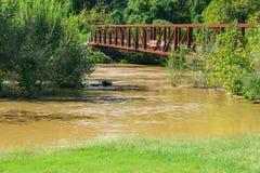 Footbridge Over a Raging Roanoke River Stock Photo