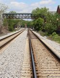 Footbridge over a railway Stock Photo