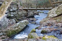 Footbridge over Roaring Run Creek. A footbridge over Roaring Run Creek located in the Jefferson Nation Forest, Virginia, USA Royalty Free Stock Images