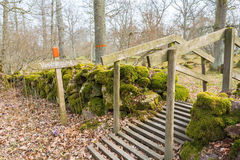 Footbridge over the stone wall Royalty Free Stock Images