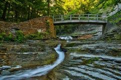 Footbridge over stream in Stony Brook State Park Stock Photo